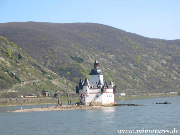 The northwestern wall of Rheinpfalz castle at Kaub, Germany, viewed from the western shore of the Rhine river