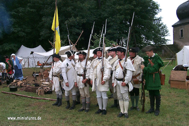 A detachment of Virginia Militia forms up near the field kitchen