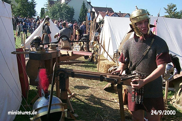 Legionnaire of Roman Legion VIII Augusta explaining the Scorpio catapult