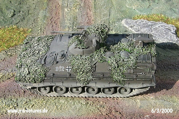 German Bundeswehr Marder 1 Infantry Fighting Vehicle with painted and weathered camouflage netting in place.